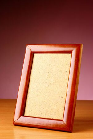 rectangular frame on the table and a red background photo