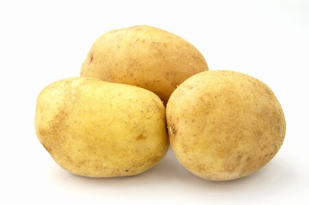 spud: tubers of potatoes on a white background Stock Photo