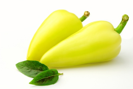 Bulgarian peppers and green basil on a white background Stock Photo