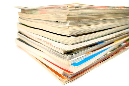 periodical: a stack of old magazines on white background