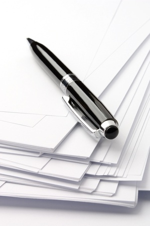 black ballpoint pen and sheets of white paper Stock Photo - 10563824