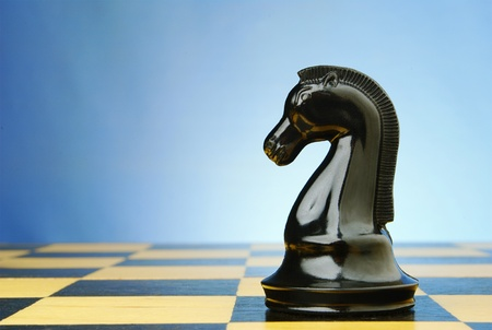 board game of chess, chess pieces on a blue background Stock Photo