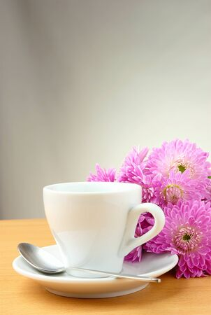white cup of coffee and lavender chrysanthemums photo