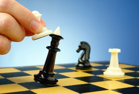 victory stand: board game of chess, chess pieces on a blue background Stock Photo