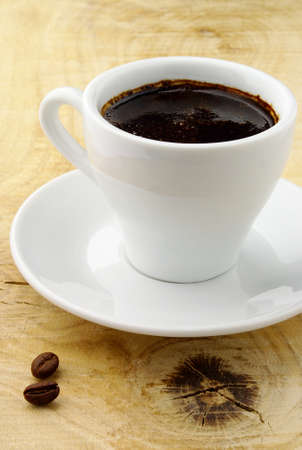 black coffee in white cup on wooden table Stock Photo - 11219765