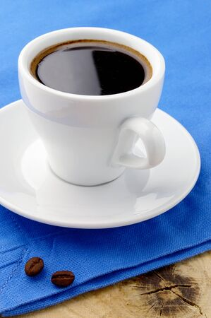 black coffee in white cup on wooden table Stock Photo - 11219763