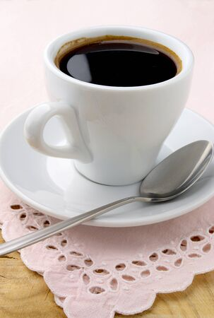 black coffee in white cup on wooden table Stock Photo - 11219756