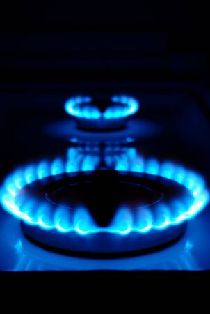 gas flame: gas burner with a flame burning home plate Stock Photo
