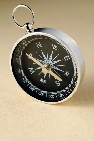 A compass and a paper form of the old yellow as parchment. Stock Photo