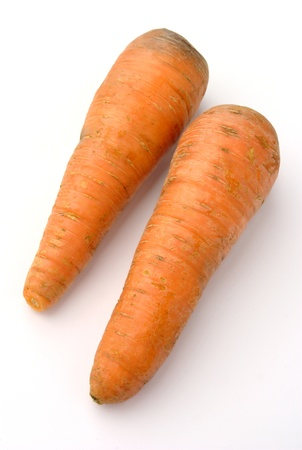 cleared: Two cleared carrots on a white background