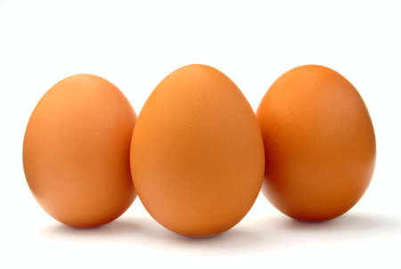 abreast: Eggs are put abreast on a white background