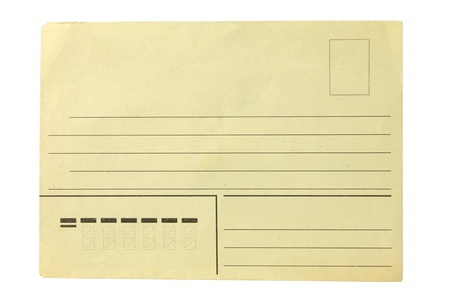 The old turned yellow post envelope on a white background photo