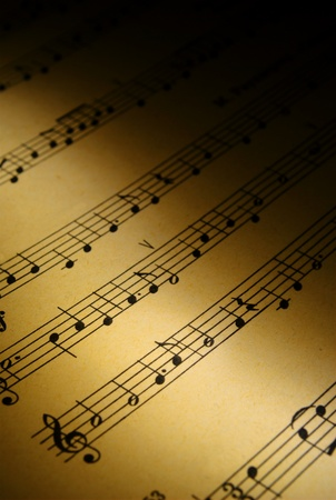 old sheet music: musical notes on the pages of an old paper