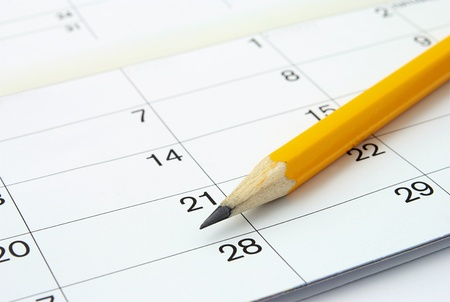 home calendar with dates and yellow sharpened pencil Stock Photo
