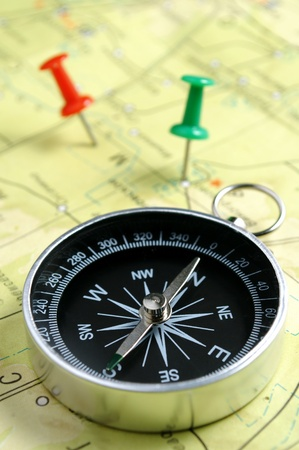 compass and marked places on the map pins