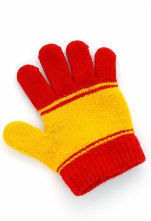 the mittens: guantes de color rojo y amarillo sobre un fondo blanco Foto de archivo
