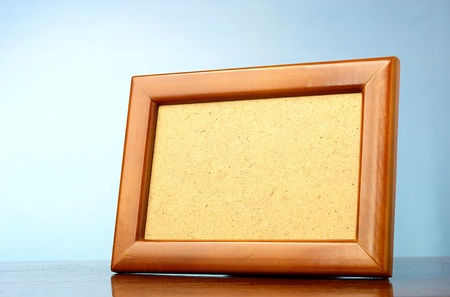 wooden photo frame on a blue background photo