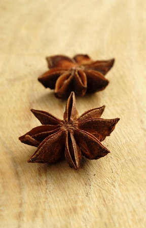 badiane: two brown star anise on the board