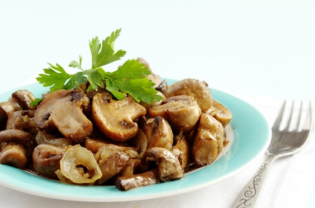 mushrooms in a bowl, decorated with greenery Stock Photo