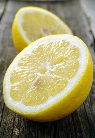 ascorbic: cut a lemon in an old dark board