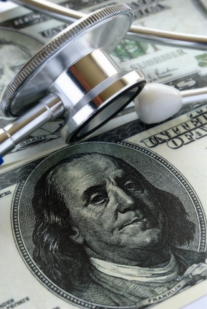 one hundred U S  dollars and stethoscope photo