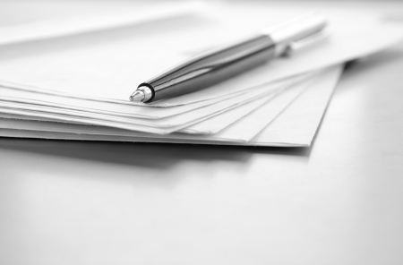 office paper: envelopes and ball pen on a table and a place for your text Stock Photo