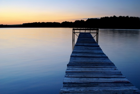 dock on the lake shore in the evening
