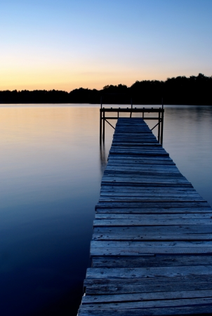 dock on the lake shore in the evening photo