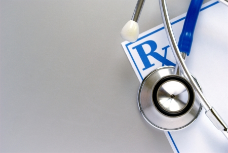 stethoscope and a prescription form, and space for your message Stock Photo - 14867285