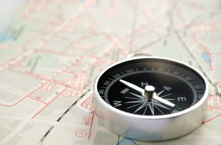 orientation: compass, map and pushpin on the table