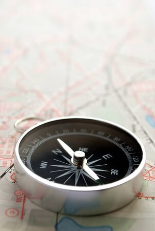 ravel: compass, map and pushpin on the table