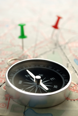 compass, map and pushpin on the table