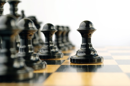 chess pieces on the board during the game photo