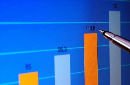 Pointing at financial analysis graph on computer monitor with pen Stock Photo - 14867288