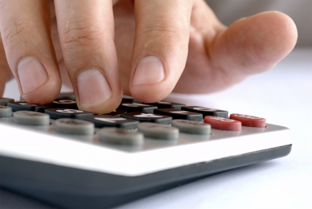 man does the calculation on a calculator photo