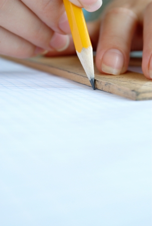 women's hands: Womens hands are working with a pencil and ruler
