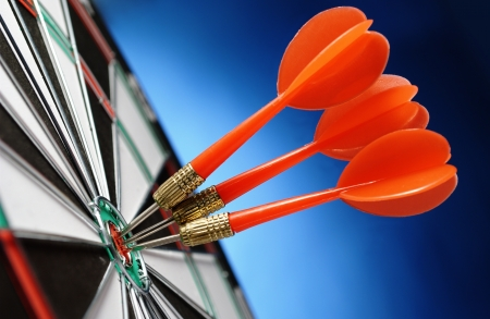 white achievement: darts arrows in the target center Stock Photo