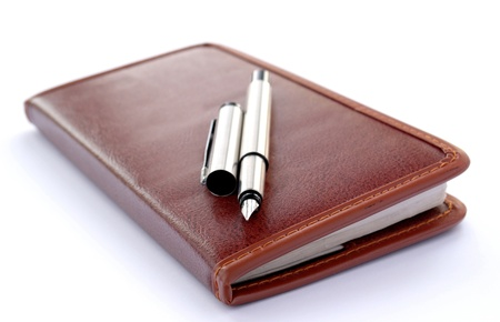 check book and a fountain pen on a white background photo