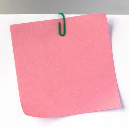 notice board: sheet of paper for notes and paper clip