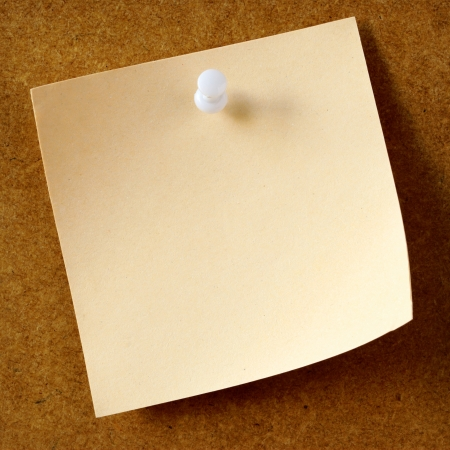memo pad: sheet of paper for notes and pushpin on the background board