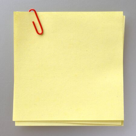 sheet of paper for notes and paper clip photo