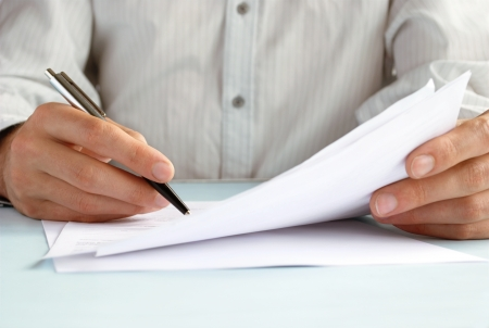 writing letter: the hand of the man does entries in official papers