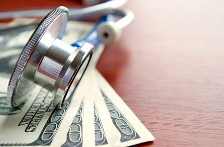 Stethoscope and dollars on the table photo