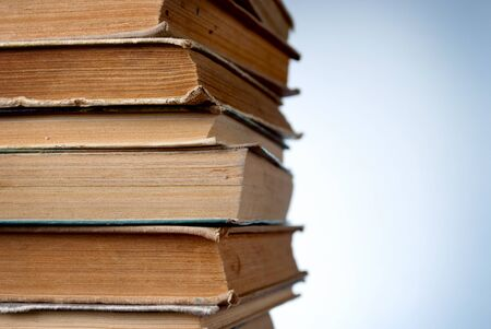 stack of old books on a blue background Stock Photo - 17163644