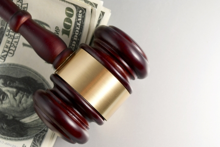 gavel and dollars on a gray gradient background Stock Photo - 17163572