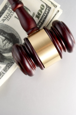 gavel and dollars on a gray gradient background Stock Photo - 17163550