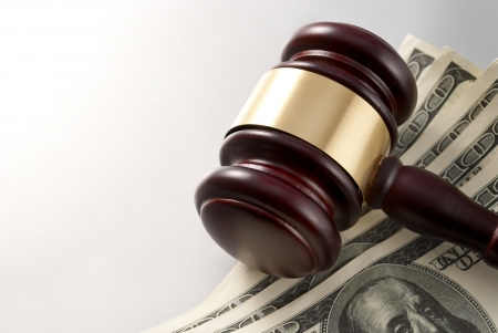 gavel and dollars on a gray gradient background Stock Photo