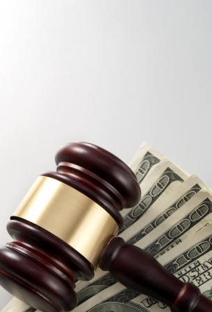 gavel and dollars on a gray gradient background Stock Photo - 17163543