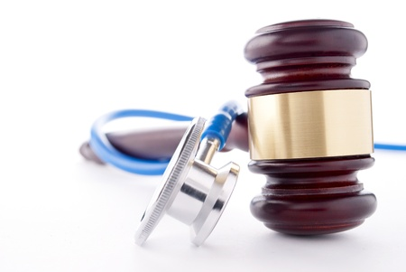 brown gavel and a medical stethoscope on white background Stock Photo - 17163477