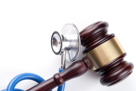 brown gavel and a medical stethoscope on white background Stock Photo - 17163487